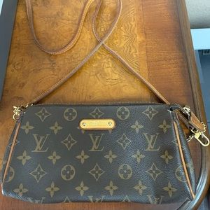 Rare Monogram Eva clutch crossbody